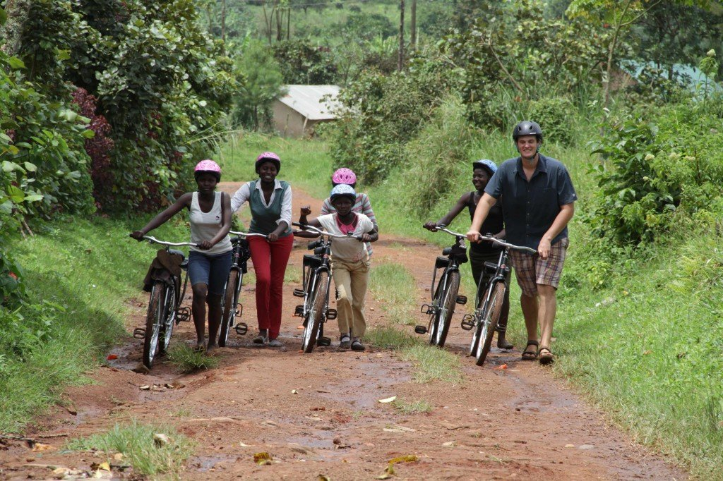 Volunteer and Girls with Bikes