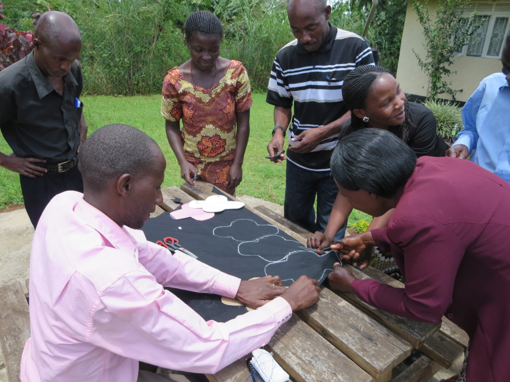 Teachers cutting fabric