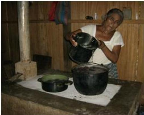 Serbelia using her new fuel-efficient stove.