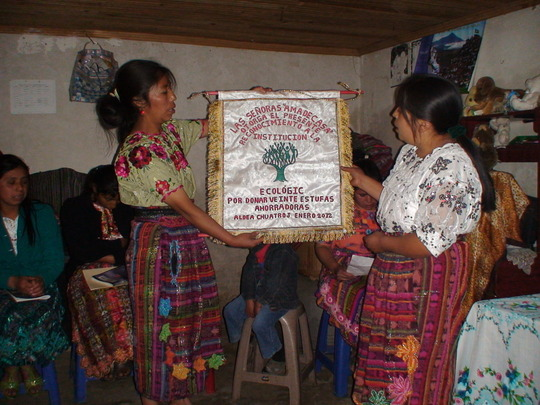 Housewives present EcoLogic with a gift of thanks.