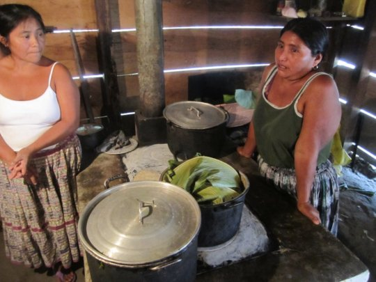 Josefina (right) and her fuel-efficient stove