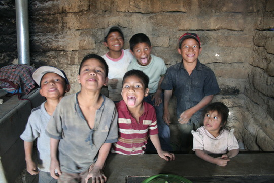 Fuel-efficient stove behind smiling faces