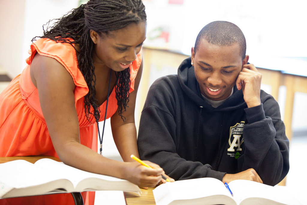 Mentors review SAT instruction with students.