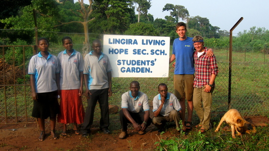 Sam, Paul and teachers in front of the new fence