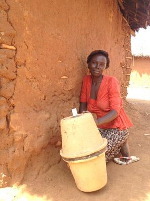 A woman who received a clay pot filtration system