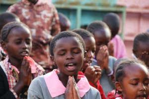Saying prayers at Assembly