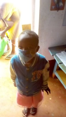 A pupil wearing our homemade mask