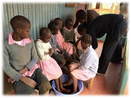 Timothy receiving treatment for jiggers at school