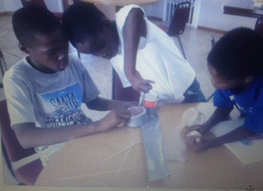 Aspiring engineers at work on the Pop Fly device