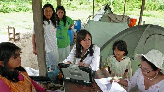 Health team conducting parasite & anemia study.