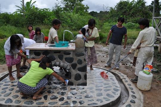 Primary school children performing maintenance on their new sink
