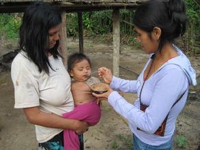 Health team giving anti-parasite medicine.