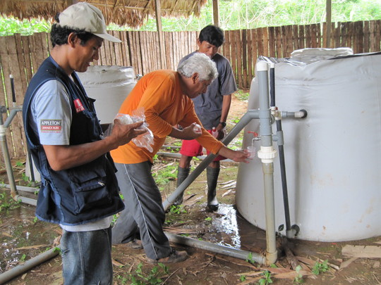 Project supervisor collecting water saftey tests.