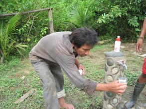 Matsigenka man conducting a H2O test at his home.