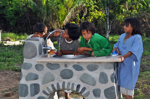 Children drinking clean H2O from school sink.