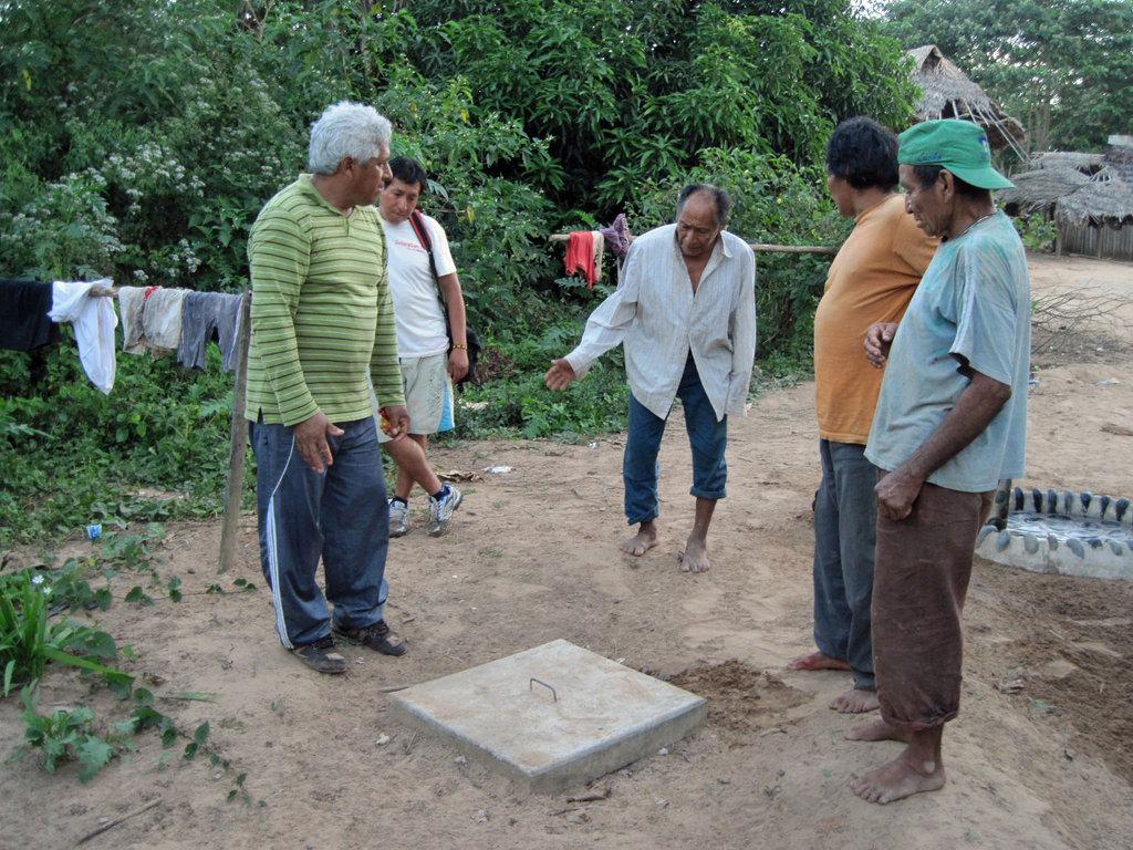 Technical training for village men.