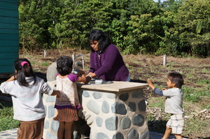 Health promoter teaching basic hand washing.