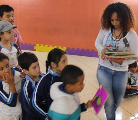 Giving out books to read