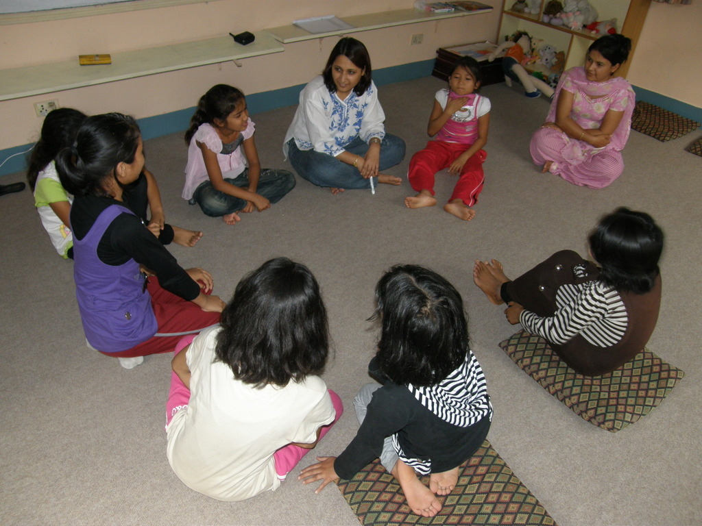 Counselor works with children in a group