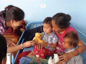 Counselor Chhori Laxmi Maharjan comforts family