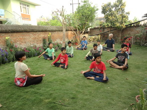 Children relax in a yoga class