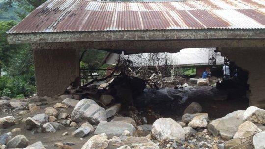 Damaged school caused by rocks from landslide