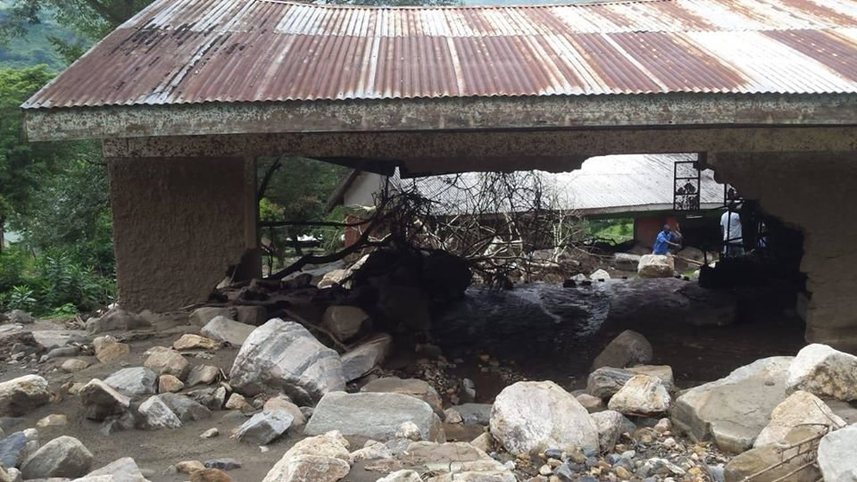 Damaged school caused by rocks from landslide