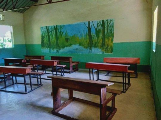 Classroom in the new school prepared for survivors