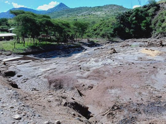 Mud slides covering what used to be a village