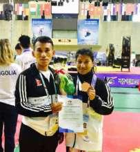 Bimala Receiving a Silver Medal in Para-Taekwondo