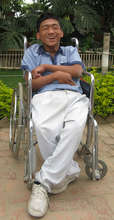 A disabled boy is happy for the gift of education