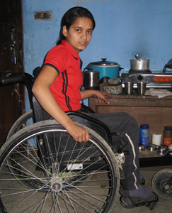 Laxmi in her wheelchair can go to school because of NYOF