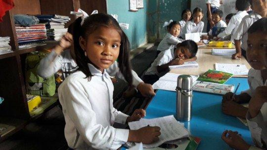 Deaf scholar Gareema learning in school