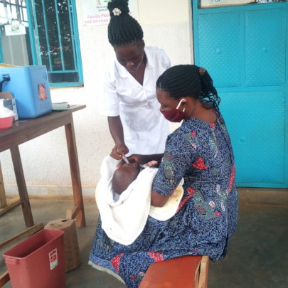 A BENEFICIARY MOTHER IMMUNIZING HER CHILD