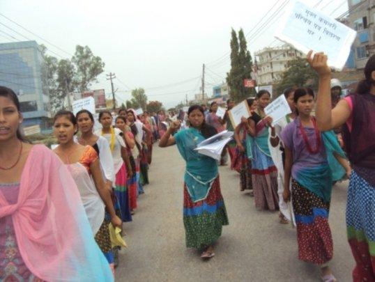 Former indentured servants protest the practice