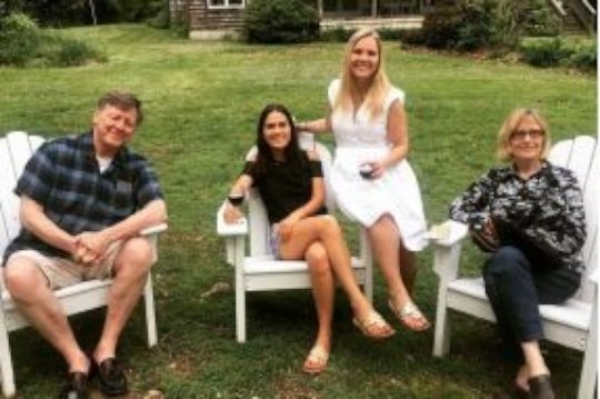 Katya, her sister, and their new parents in the US