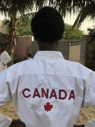 karateka wearing a donated uniform