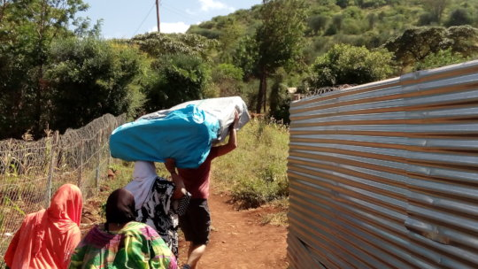 Our project staff delivering the mattress