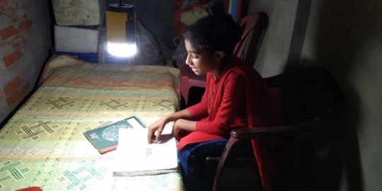 Students are continuing education using solar lamp