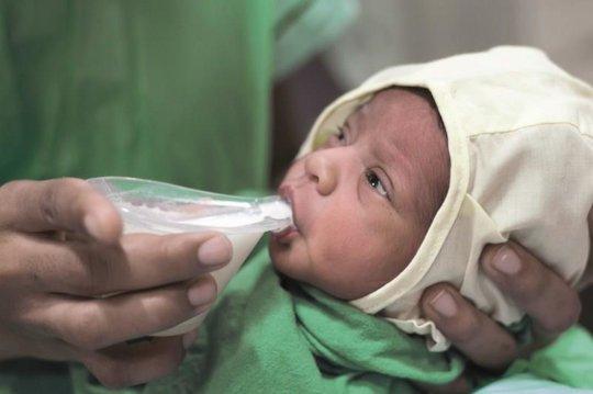 Feeding Milk from Nifty Cups