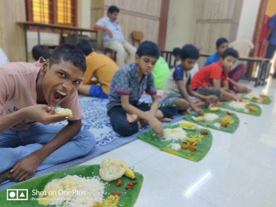children rescued having a Sadhya(Traditional meal)