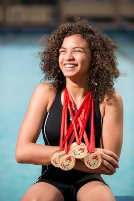 Malak wears her medal