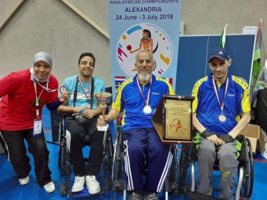 Walid with his Coach and Friends