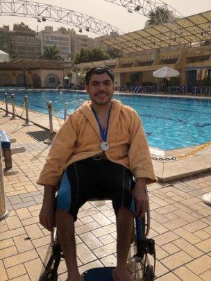 Abanob wearing his medal