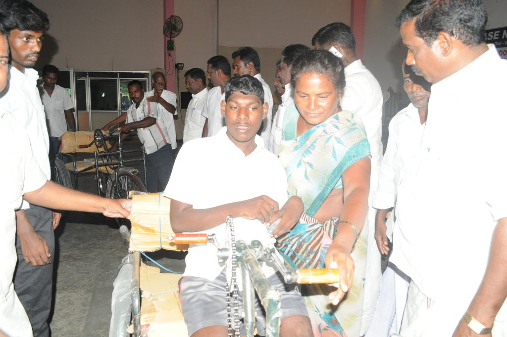 Tricycles to 3 disabled children