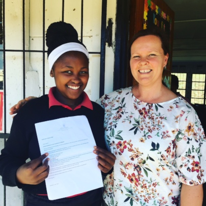A delighted Linako and her teacher, Sharon