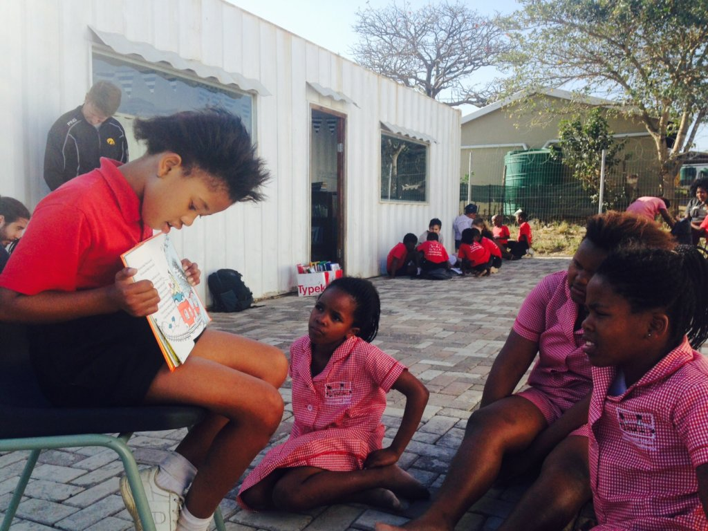 Learners practicing reading to other learners.