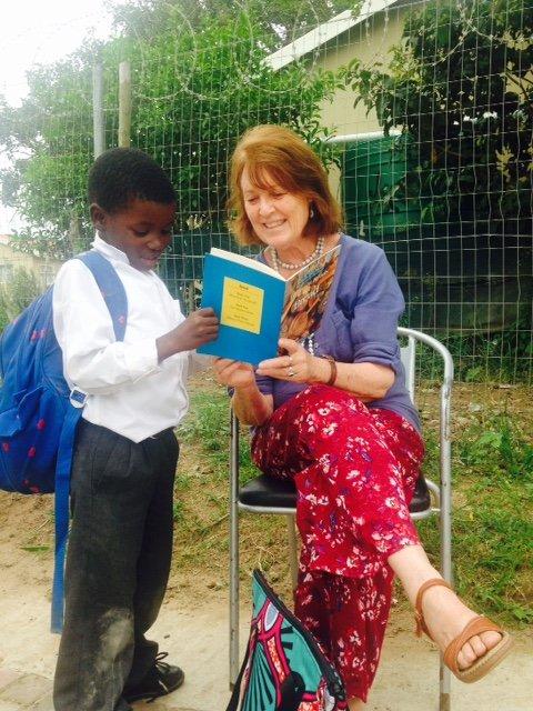 Barbara M and her young learner at Siyafunda