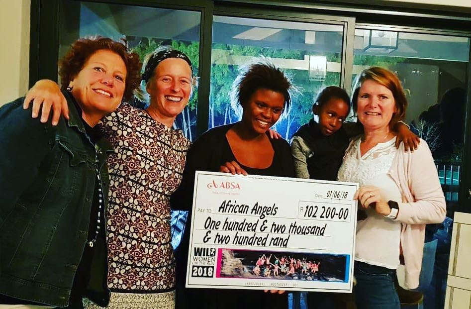 Wild Women On the Run hand over their 2018 cheque