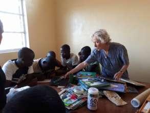 Marguerite teaching the children dominoes
